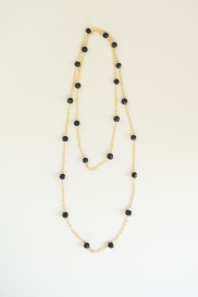 Black fair-trade beads from India with gold chain.